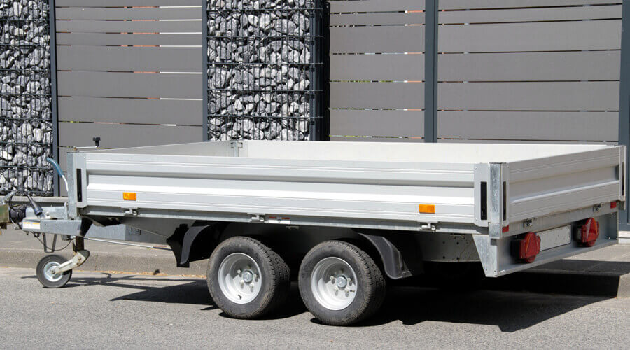 Car trailer ready for attachment and towing