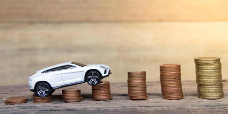 toy car climbing up coins