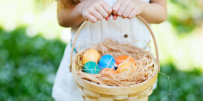 Young Girl Holding An Easter Egg Basket
