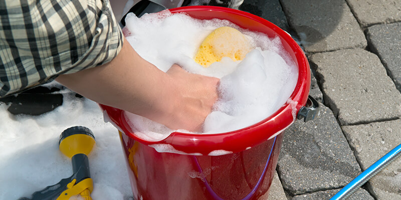 Bucket Of Soapy Water With A Sponge