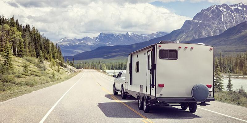 Caravan Driving Towards Mountainous Scenery