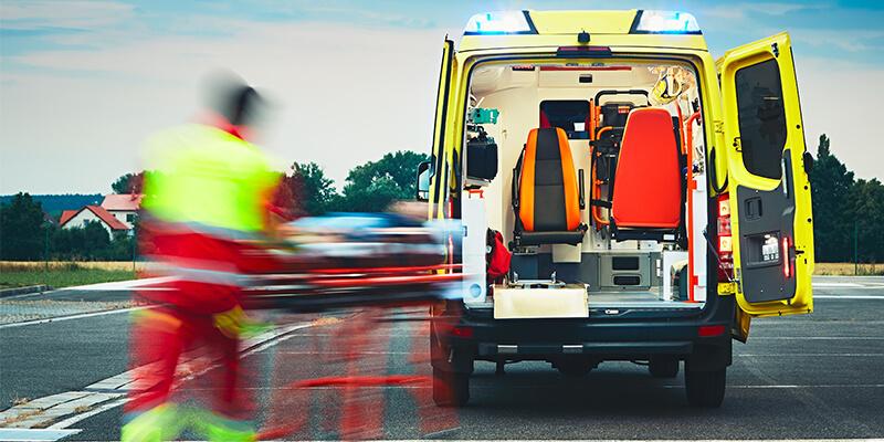 Paramedic Rushing To An Ambulance