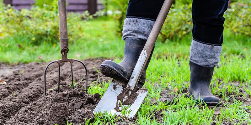 gardener digging grass