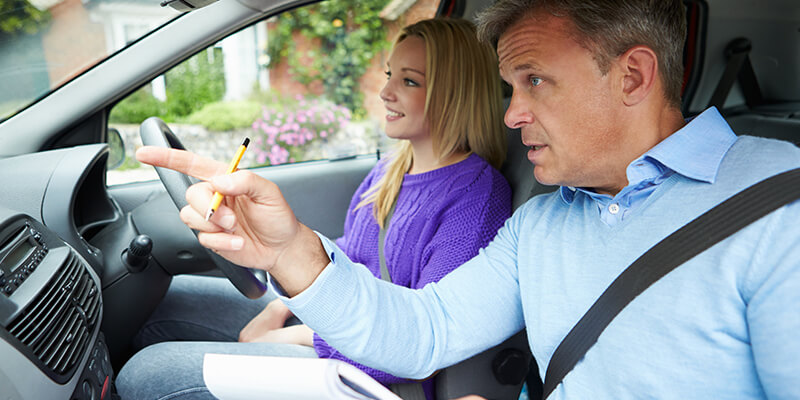 driving instructor with pupil