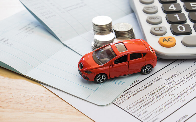 toy car on paperwork