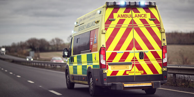 ambulance driver on dual carriageway
